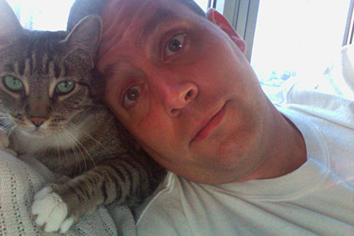 "Peter Shankman and his cat Karma, pre-bath. ""The key is not to leave any part of your skin exposed,"" he says.                                             (Sally Herships)"