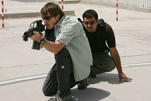 Private security contractor Steve Cameron trains an Afghan operative at the ArmorGroup Close Protection base in Kabul, August 2007. London-based ArmorGroup is one of the largest private security companies working in Afghanistan.                                             (Paula Bronstein/Getty Images)