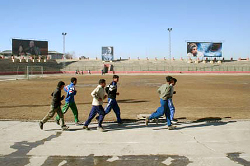 Young Afghans exercise in Kabul's stadium, previously used by the Taliban for public executions.                                             (Gregory West)