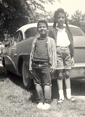 "Desiree and her brother Bill standing beside ""Old Betsy,"" the 1954 Buick Special that carried them on countless cross-country road trips with Dad at the wheel.                                             (Courtesy Desiree Cooper)"