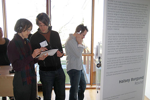 Halsey Burgund (center) explains his interactive art project to a museum patron.                                             (Courtesy Halsey Burgund)