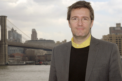 Danish artist Olafur Eliasson standing in front of the Brooklyn Bridge.                                             (Courtesy Public Art Fund)