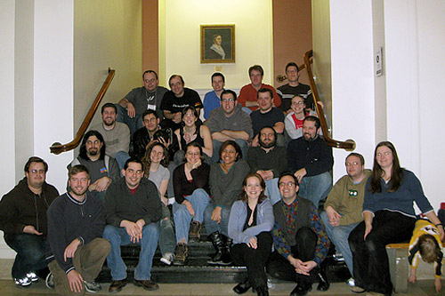 "The team ""Evil Midnight Bombers What Bomb at Midnight"" gather 20 minutes after winning the 2008 MIT Mystery Hunt. Weekend America guest Dan Katz is in the second row from the top, second in from the left, and Francis Heaney is in the bottom row, third from right.                                             (Lorinne Lampert)"