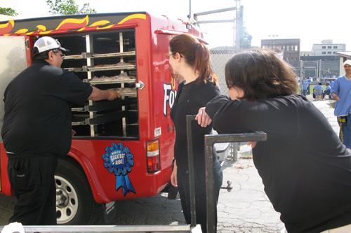Volunteers greet Dave's Famous Barbeque truck.                                             (Nancy Mullane)