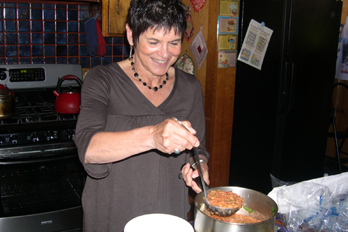 "Jeannette Ferrary ladles up the ""wolf"" that she just cooked, that is, Gaspacho soup.                                             (Krissy Clark)"
