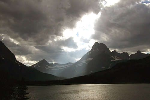 Sun streams through the clouds over Many Glacier Valley.                                             (Michael May)