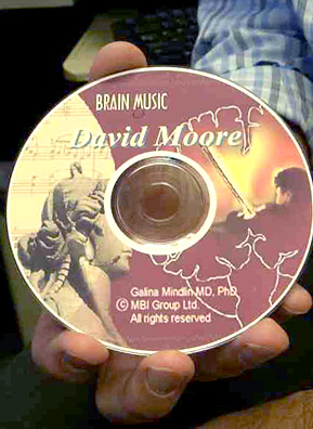 Brain Music Therapy, or BMT, is a personalized composition created using a patient's own brain waves. Pictured here is Weekend America guest Dr. David Moore's brain music CD, which he uses for sleep apnea. Patients' names are printed on each disc.                                             (Jim Gates)