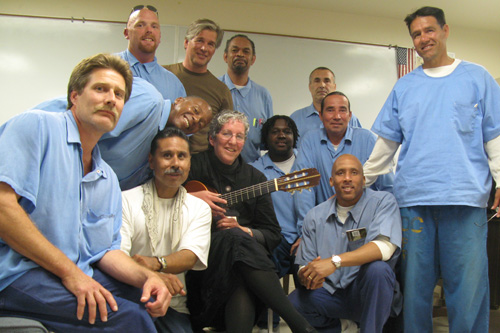 Jaimee Karroll and Jacques Verduin with the inmates in the Insight Prison Project.                                             (Nancy Mullane)