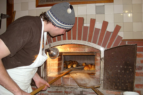 Pictured here is the handmade, wood-fired brick oven at the Back Alley Bakery in Hastings, Neb. It cooks bread at 600 degrees, giving it a crunchy, light brown crust.                                             (Martin Wells)