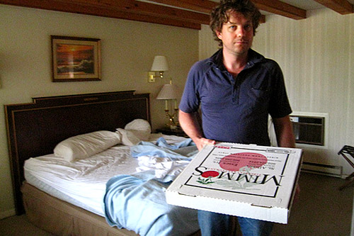 The morning after the escape, Maxon holds leftover pizza at the Cadillac Motel as guilt is sets in.                                             (Khanh Tran)