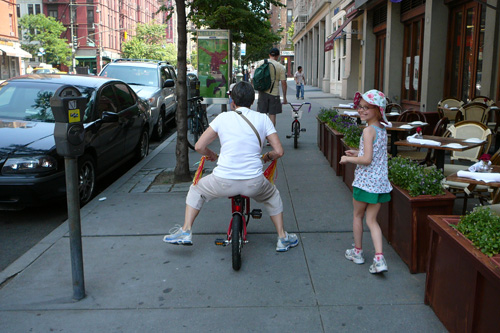 Fiona Hinds, age eight, appreciating the biking technique of her grandmother, Eleanor Katz.                                             (Kate Hinds)