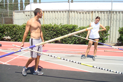 Pole vault coach Brooks Morris and one of his students take five in between vaults.                                             (Charlie Schroeder)