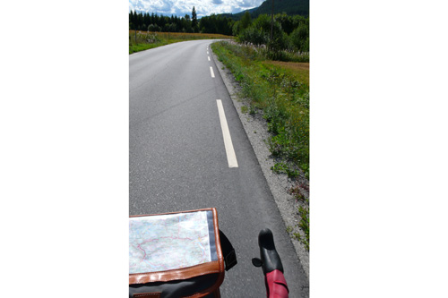Pretty much our constant view from the handlebars. Bicycle tourism puts you in the landscape, and the world goes by at just the right speed for observation.                                             (Leif Larsen)