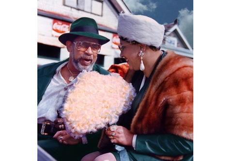 Edwin and Rose Harrison as King and Queen of the Moneywasters Social Aid and Pleasure Club Parade in December, 1991. The couple was flown into the parade via helicopter and driven in a white, horse-drawn carriage. Curt had no idea about Edwin's colorful, prominent life in New Orleans until Edwin entrusted him to restore his pictures and videos.                                             (Curt Peters)