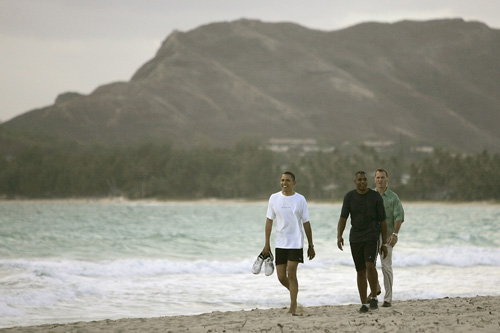 "Burley recalls Obama's expression, ""He just looked really relaxed and just glad to be off the campaign trail...  To me, it just looked like a guy without a care in the world taking in the beauty of Hawaii.""  The third man in the photo in the green shirt is with the Secret Service.                                             (Mike Burley, The Honolulu Star-Bulletin)"