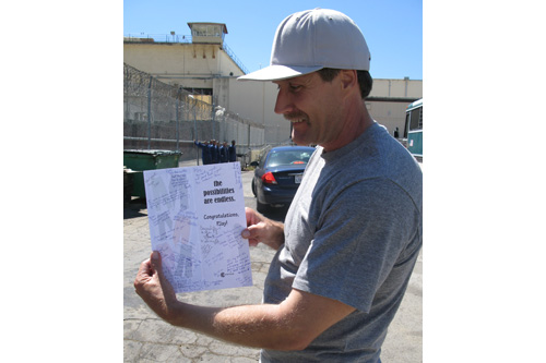 Philip J. Seiler shows his good-luck card as he gets ready to leave California's San Quentin State Prison after 20 years behind bars.                                             (Nancy Mullane)