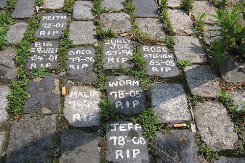 Yong Lee painted each cobblestone with the kind of white paint you'd use to paint the exterior of a house. Most of the names listed on the memorial are either just nicknames or first names.                                             (Jonathan Menjivar)