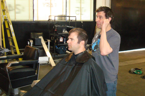 Michael Anthony cuts reporter Charlie Schroeder's hair.                                             (Tim Bomba)