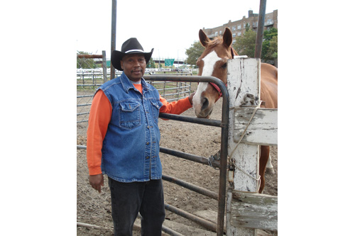 "Doug ""Dirty Dog"" Elder shows off his horse, Little Jack.                                             (Eric Molinsky)"