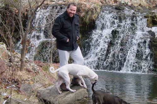 Kevin Bunten with his dogs, hiking on his property in rural Missouri.                                             (Courtesy Kevin Bunten)