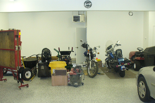Inside Kevin Felici's garage: His Harley is on it's own rug, next to his brand new Sears Craftsman lawnmower.                                             (Kevin Felici)