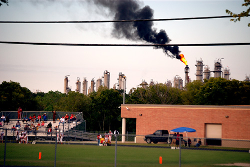 The Texas Petrochemicals flare above Cesar Chavez High School in Houston.                                             (Bryan Parras)