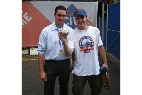 Zack Hample poses with a baseball authenticator after he caught the last home run ever hit by a New York Met at Shea Stadium.                                             (Courtesy Zack Hample)