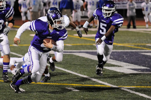 The Piedmont High quarterback Jeremy George on the run.                                             (Pat Krausgrill/Piedmont Post)