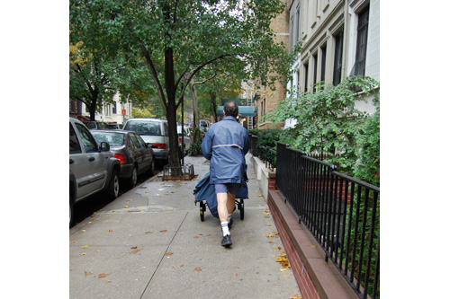"Your mailman may know more than you think about you: ""Marco"" walking his route in Manhattan.                                             (Kate Hinds)"