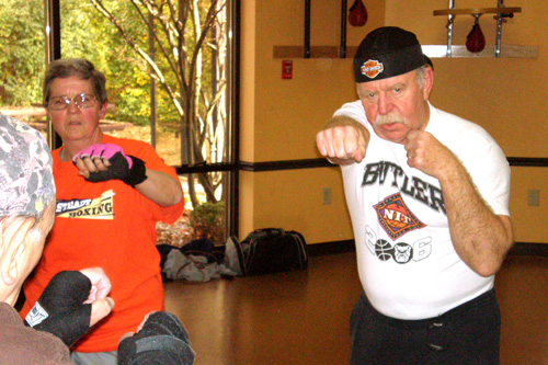 Mary Yeman and Don Schafer warm up for their boxing class. Both were diagnosed with Parkinson's a few years ago.                                             (Colleen Iudice)