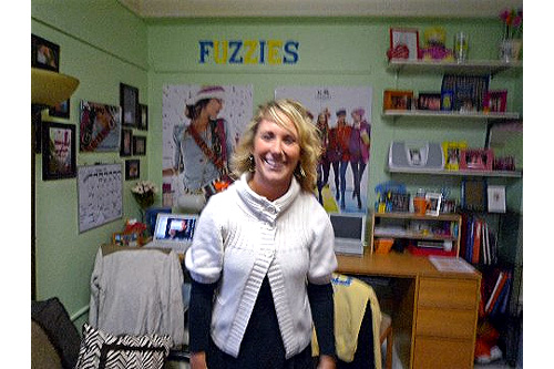 "Caitlyn poses in her dorm room. Her sorority sisters see her as ""happy-go-lucky.""                                             (Desiree Cooper)"