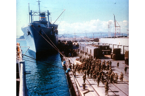 American troops await their turn to board the troopship General Nelson M. Walker at the Naval Supply Station, Oakland, California, sometime in 1966. The Walker was over 600 feet long and could carry as many as 5,000 troops during each of her voyages. It took from 18 to 21 days to reach Vietnam.                                             (Courtesy Naval Supply Station)