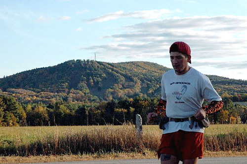 John Lacroix is running across the state of New Hampshire with his friend Nate Sanel. If one runner feels particularly good or bad, they'll separate and reconnect up the road. Here, John goes off on his own for a stretch.                                             (Sarah Chretien)
