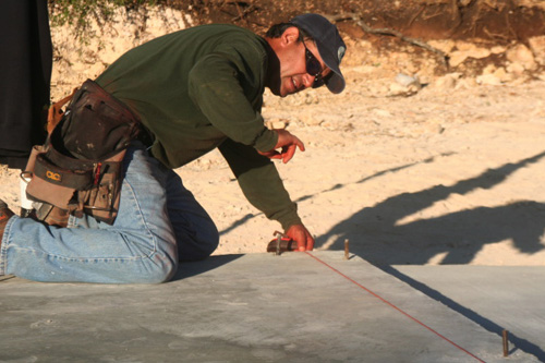 Ramiro Mora snaps a chalk line.                                             (Michael May)