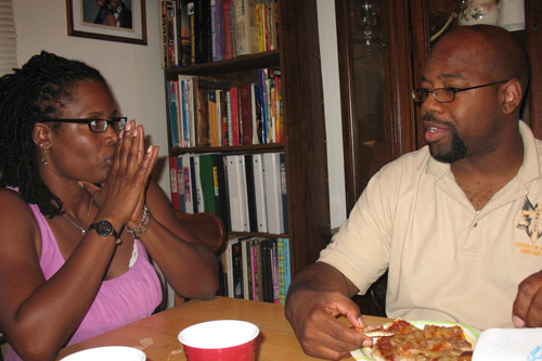 Jamillah Gilbert discusses houses she's been viewing while her husband, Mark, has dinner.                                             (Laurie Stern)