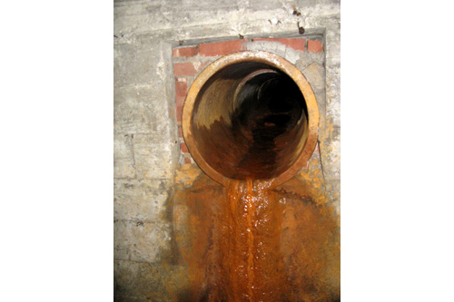 Toxic residue filters down from gutterboxes into the drain tunnels.                                             (Adam Allington)