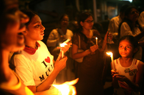 Indians light candles as thousands of Mumbaikars take part in a mass demonstration march following last weeks' series of terrorist attacks on the city.                                             (Uriel Sinai/Getty Images)