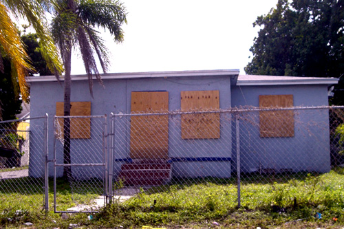 Abandoned homes like this one are a common sight in Miami's impoverished Liberty City neighborhood.                                             (Andrew Stelzer)