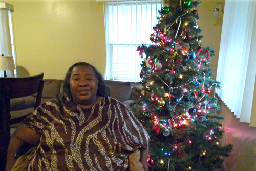 Helen Hatcher sits next to her Christmas tree. She and her sister Charnita have planned a menu for Christmas that includes homemade desserts and freshly baked bread.                                             (Desiree Cooper)