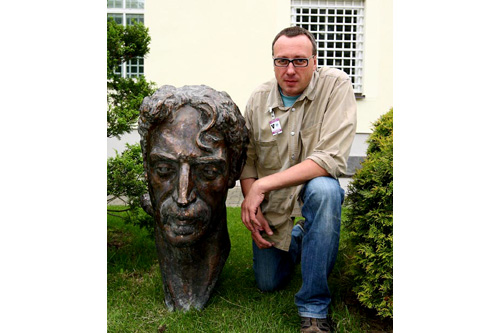 Saulius Paukstys stands with the new Frank Zappa bust that he helped get commissioned. The replica will remain in the U.S. Embassy in Vilnius until Baltimore finds a site for it.                                             (Arturas Baublys)