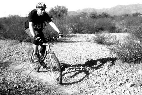 Charles Wommack biking through Tucson Mountain Park.  It was his second ride back on his mountain bike.                                             (Courtesy Charles Wommack)