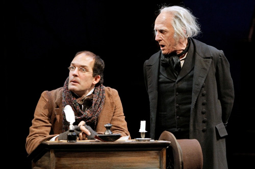 Michael Booth (Bob Cratchit) and Raye Birk (Ebenezer Scrooge) in the Guthrie Theater production of A Christmas Carol, by Charles Dickens.                                             (Michal Daniel)