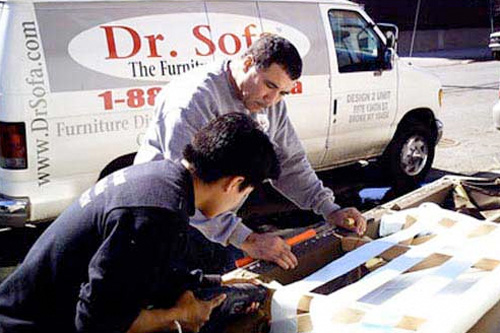 Dr. Sofa (Greg Gomez and Mario Quito) get ready to slice apart a sofa to fit it into a New York City apartment.                                             (Shlomi Eini)