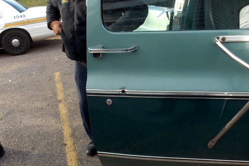 Officers retrieved the stray bullet that went through this truck's door.  It was in near perfect condition, which helps the ballistics department identify the gun.                                             (Marc Sanchez)