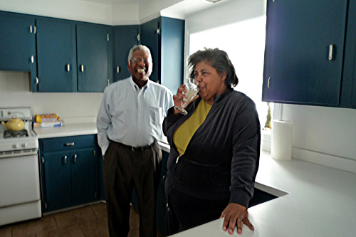 Connie and Romey enjoy lemonade in their kitchen. They plan to be in this smaller home throughout their retirement years.                                             (Desiree Cooper)