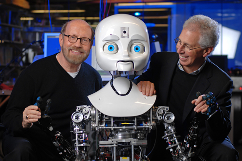David Kirkpatrick and Frank Moss, director of the MIT Media Lab, with Nexi.                                             (Sam Ogden)