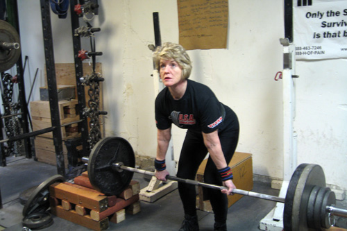 Faith Ireland lifting weights in her Seattle gym.                                             (Jeannie Yandel)